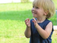 happy child clapping